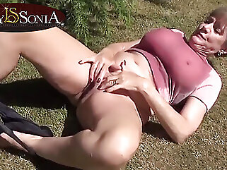 Lady Sonia lubes up her boobs and masturbates outdoors mature blonde
